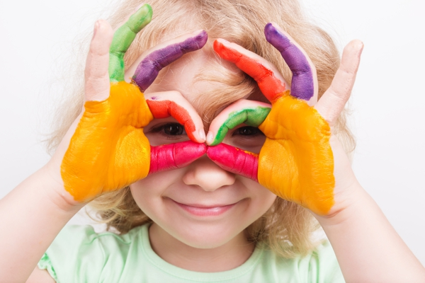 Little girl  hands painted in colorful paints